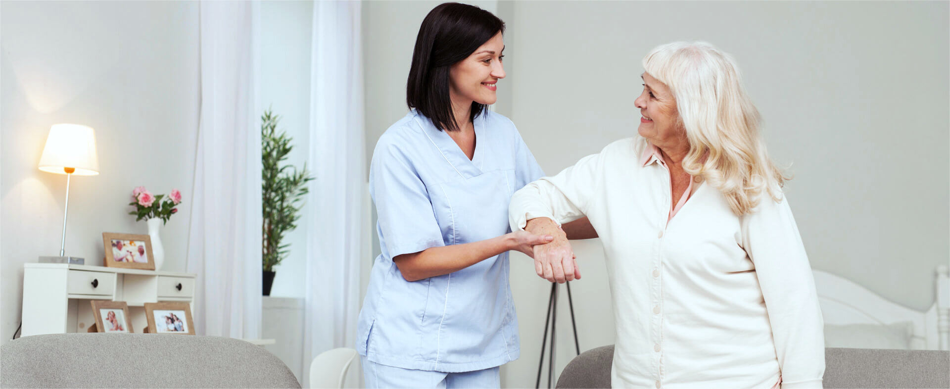 caregiver assisting an elder