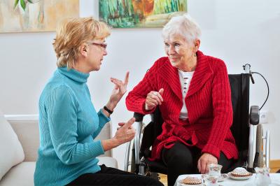 woman and elder woman talking