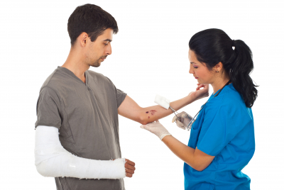 nurse cleaning the wound of injured man