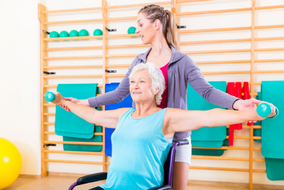 Senior woman in a wheelchair doing physical therapy